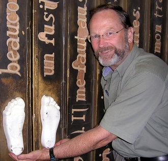 A photo of Rees holding white footprints.